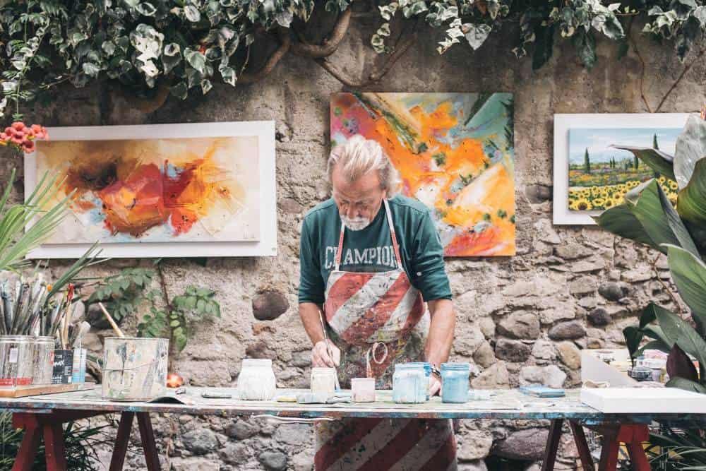 Artist working on paintings